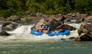 Rafters shoot the white water.