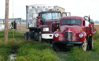"The ""binder"" makes short work of pulling the Mack free of the mud hole. The term ""binder"" was a nickname, even a term of endearment for International Harvester trucks. The term has recently fallen to disuse, due to the restructuring of the International Harvester company."