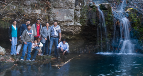 Two families and friends enjoy the falls at Lake Catherine State Park near Hot Springs AR.