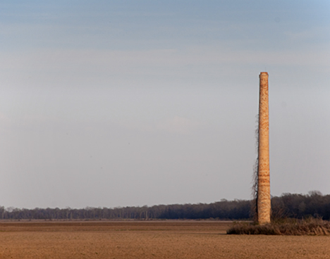 A few miles north of Wilmot you see a smoke stack, jutting like an asparagas spear from a plowed field. It is what's left of the Jerome Relocation Center.