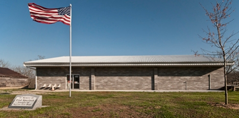 "Old Glory snaps in a stiff breeze at the Squires Community Center. Residents of the community raised the money and built the center themselves, a concept too often forgotten in this day and time. (Old military guys remember the term ""full value wind,"" this is it)."