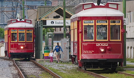 "I'm not certain what the names of these New Orleans street cars are, but I'm willing to bet it's not ""Desire."" These are disgorging and taking on passengers at the Toulouse Stree stop in the French Quarter."