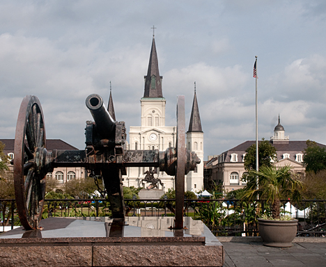 Praise the Lord and pass the ammunition. A cannon aimed toward the Mississippi River stands guard over Jackson Square in New Orleans' legendary French Quarter. In the background is St. Louis Cathedral, founded as a parish in 1720. It is the oldest Catholic cathedral in the United States.