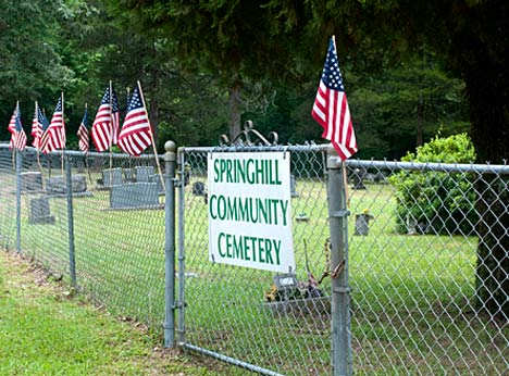 Remembrance and respect knows no geographic limitations. Spring Hill Community Cemetery can be found only after a trip on a gravel road. That does not diminish the sacrifices here represented.