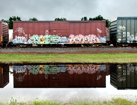 These rail cars were obviously in one place too long and the grafitti artists made good their spray-can attack. Being an old art director (among other things), I can see some takented handiwork here along with some applied forethought as to appearance.