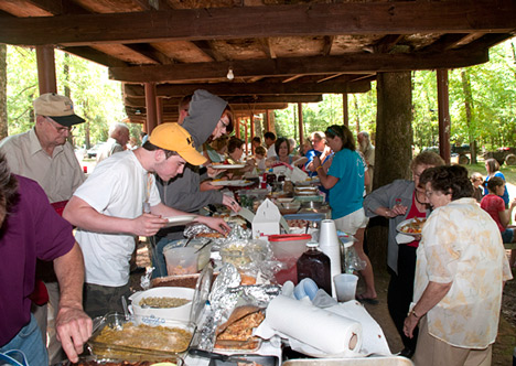 What you see here is southern potluck at it's finest. And you are seeing just a fraction of it. There are five more tables just like this one, brimming with mouthwatering cuisine from home kitchens. It's chow-time at the 133rd  Marks-Barnett Family Reunion in Cleveland County, Arkansas.