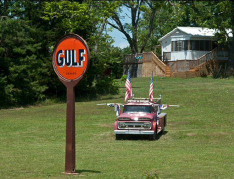 Gulf sign and old fire truck