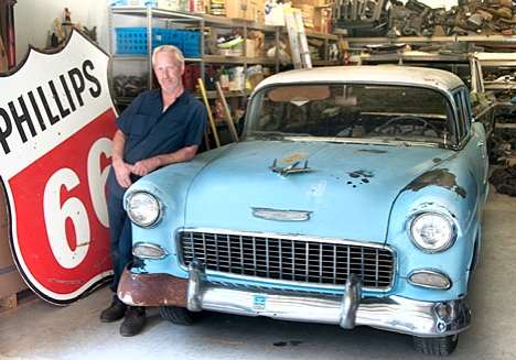 "Joe Webb at home with the latest addition to his stable of '55 Chevys. This one makes number eight. Add 22 ""parts"" cars of the same vintage, plus a shop full of 55 parts."