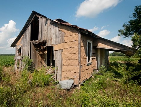 Notice the front porch on this old farmhouse, no visible means of support.
