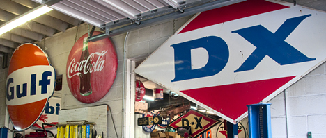 The main shop entrance gives you an idea of what to expect. The DX and Gulf signs are signficant to the history of the business. At one time, the shop was also a service station that carried both brands.