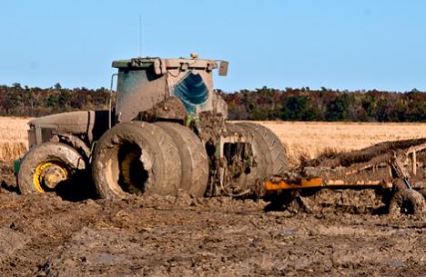 mud encrusted tractor