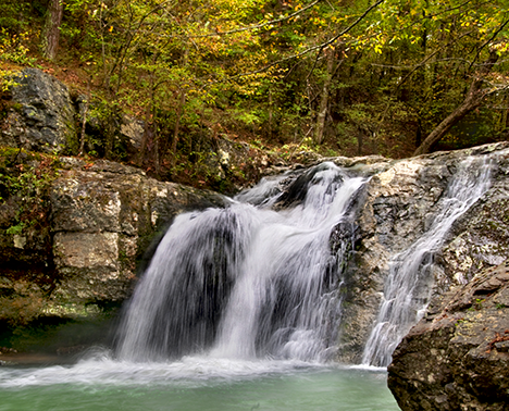 "These falls at Lake Catherine State Park, near Hot Springs, Arkansas are about midway in a relatively easy hiking trail that loops from a camping area along the lake shore. A healthy rain the day before this shot gave the falls a bit more oomph, a plus for the ""WOW!"" factor."