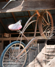 old bike hanging in barn