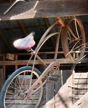 old bike hanging in barn