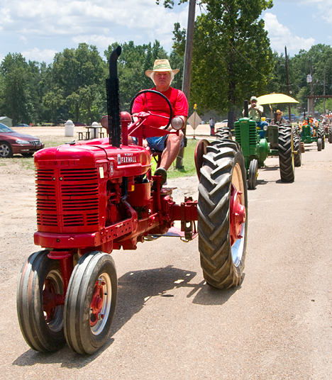 Color coordinated tractor and driver attire in the parade.