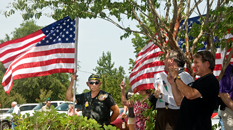 Patriot guard stands by flag