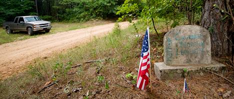 roadside tombstone and american flag