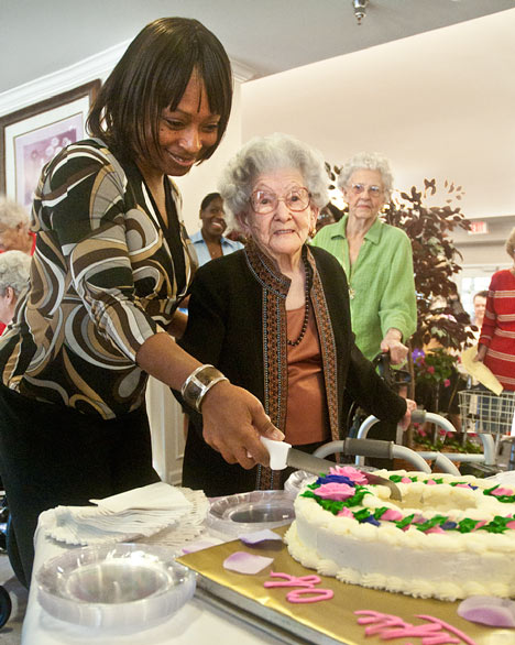 Nina Hunt and Lucille Montgomery cut the cake