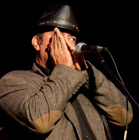 One eyed harmonica player