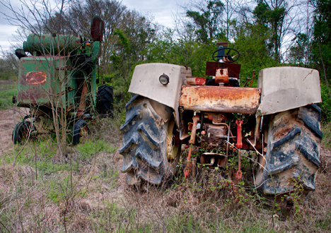 abandoned tractor and combine