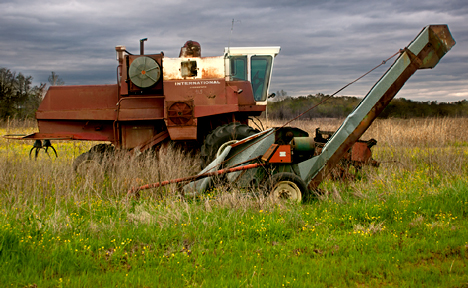 abandoned combine and grain auger