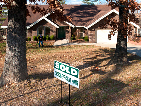 new house with sold sign