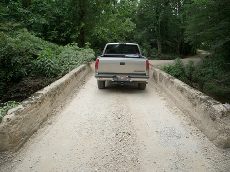 pickup truck on narrow bridge