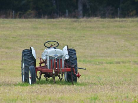 Old Ford tractor broken down in field