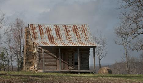 old log cabin on Arkansas Highway 9