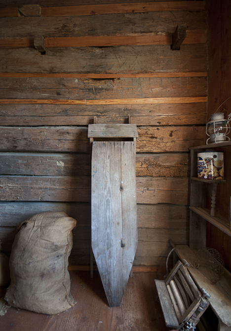 Log wall in storage room