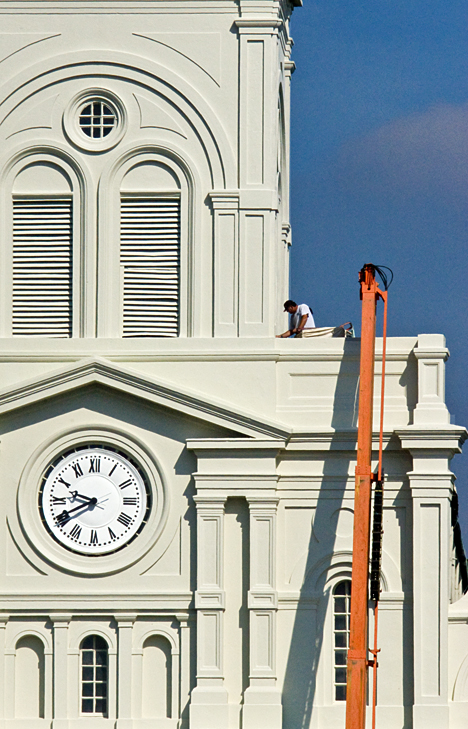 Maintenance worker on St. Louis Cathedral in New Orleans