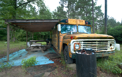 old school bus converted to deer camp