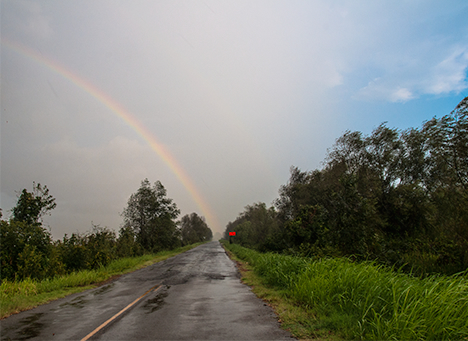 rainbow at the end of a road