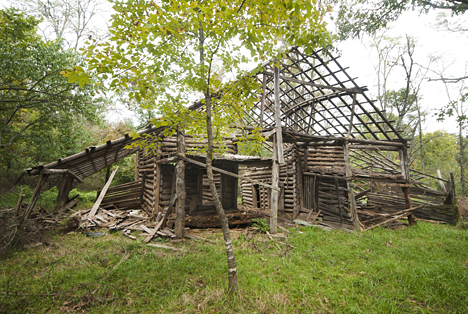 old primitive house-barn combination