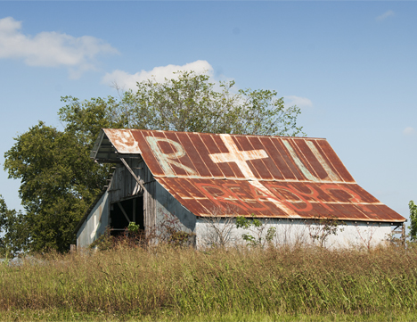 Old barn with cross on roof