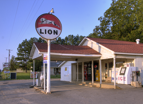 store with old lion oil sign