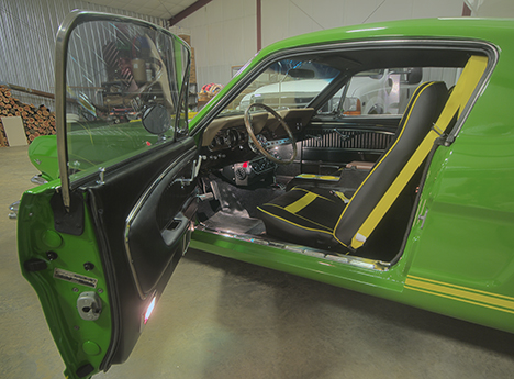 door and interior dashboard view of 66 mustang converted to pickup truck