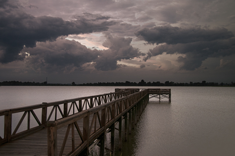 Fishing pier in storm on Lake Saracen in Pine Bluff Arkansas