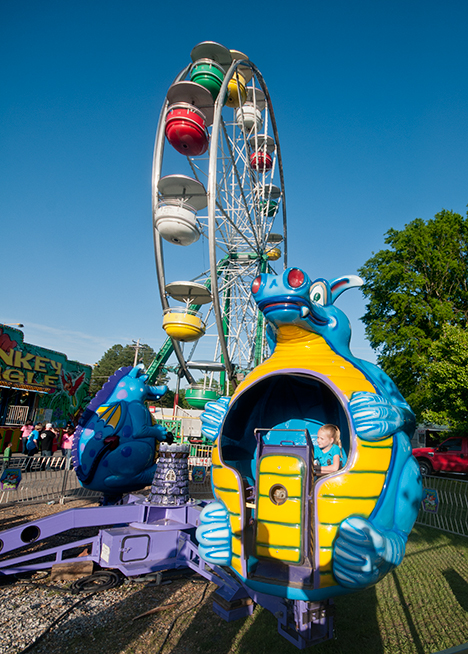Child dragon ride at carnival