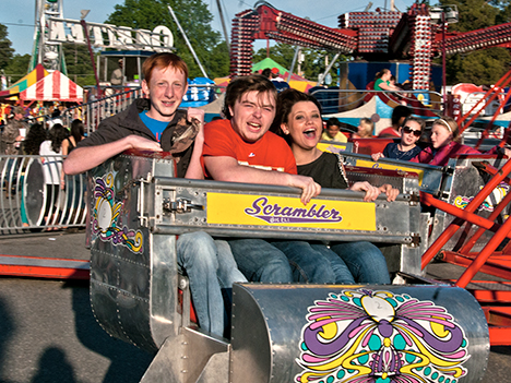 "Three people riding the 'scrambler"" at star daze"