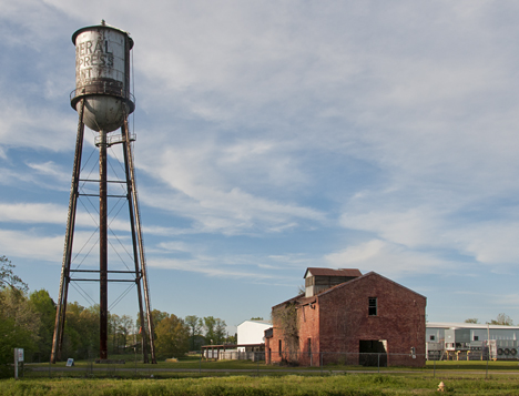 Old compress water tower and building on same premises as an ice company