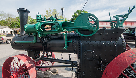 Close of of cylinder on steam tractor