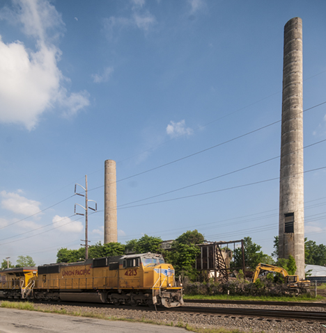 Train in front of old power plant