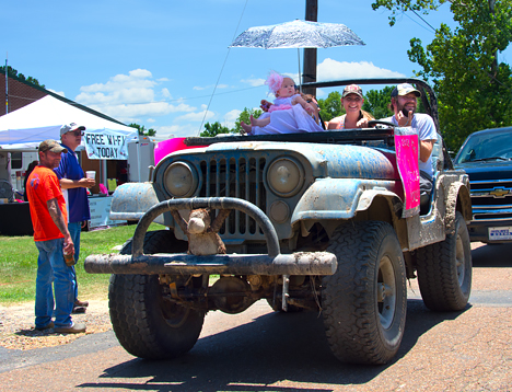 Family in jeep in parade