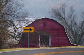 red barn in curve