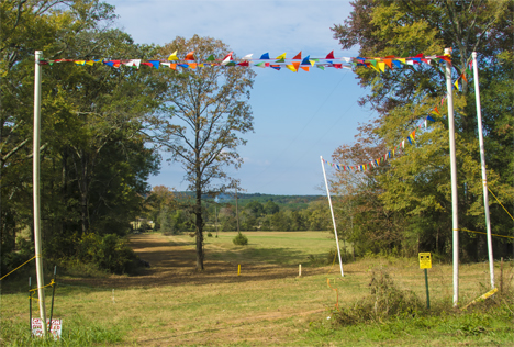 entrance to field with overhead flags