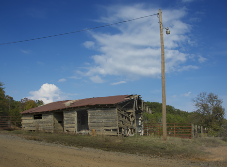 old rural utility bulding with blue sky background