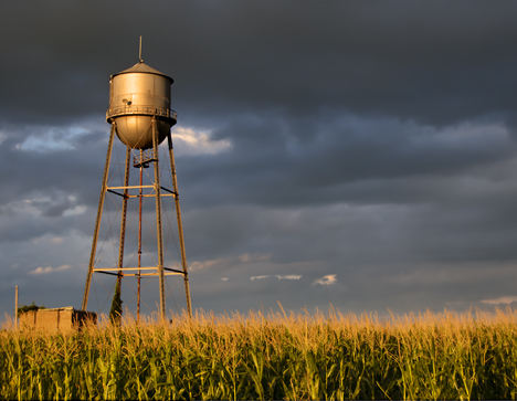 Water tower at Lake Dick Arkansas with approaching storm