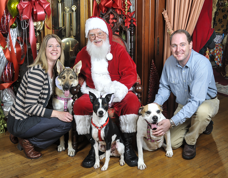 family with three rescue dogs and santa