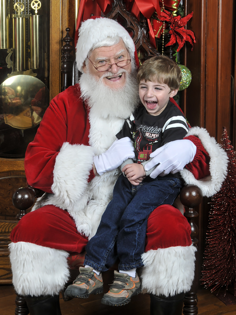 happy boy on santas lap